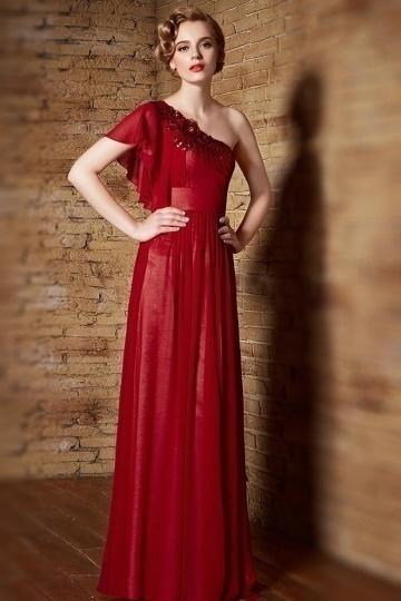 Robe de cérémonie rouge empire asymétrique avec fleur et mancheron volanté
